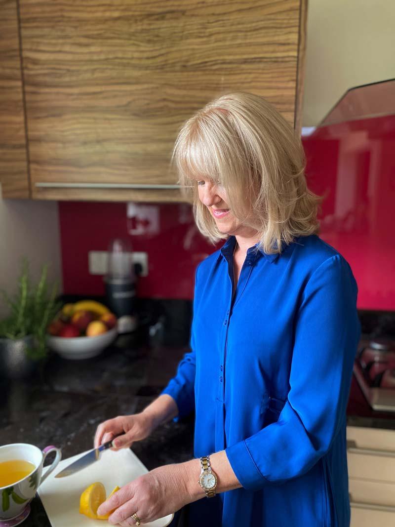 Alison Peacham registered nutrional therapist chopping a lemon