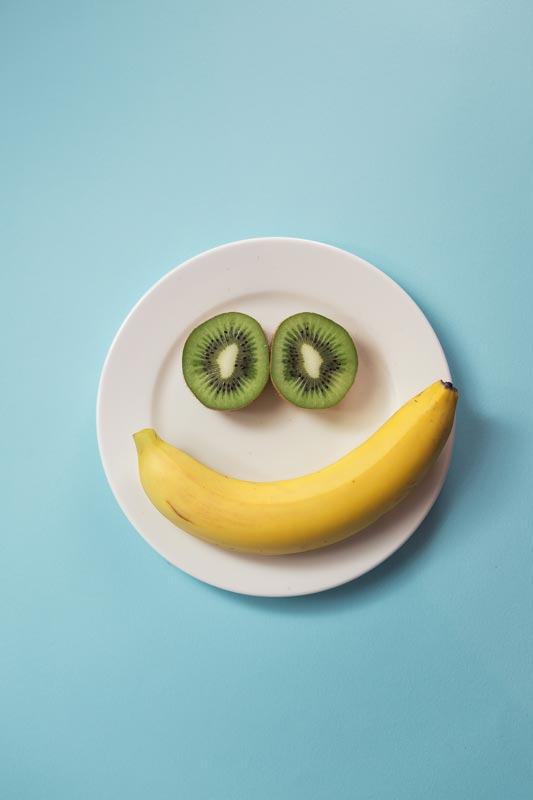Childrens nutrition fruit face on plate